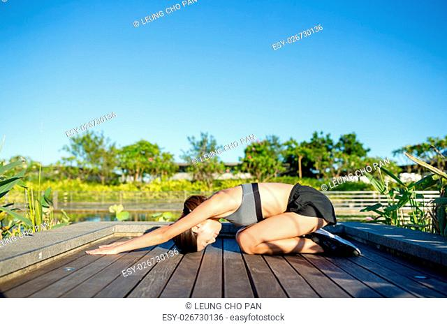 Woman in yoga pose at park