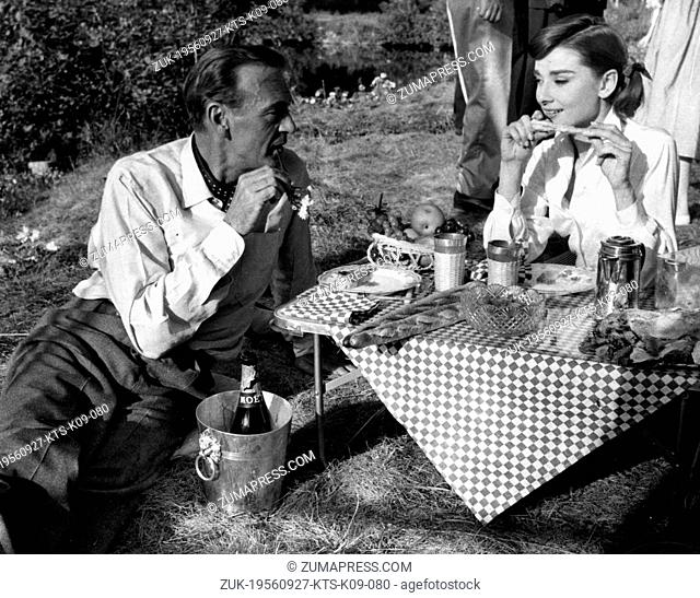 Sep. 27, 1956 - Paris, France - Film star GARY COOPER (1901-1961) with co-star AUDREY HEPBURN (1929-1993) eating lunch alfresco during the shooting of the film...