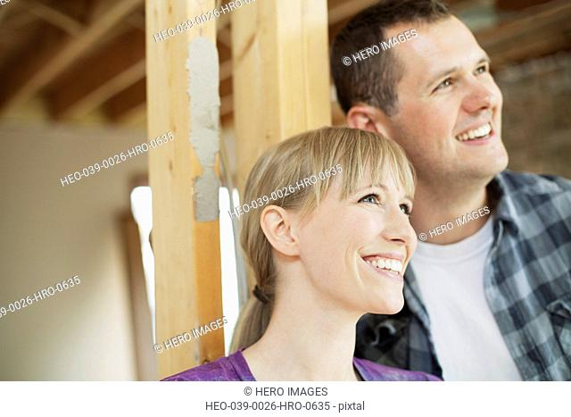 happy mid adult couple in house renovation