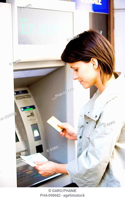 Woman withdrawing money from a cash machine