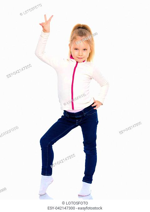 Beautiful little girl gymnast shows her thumb up. The concept of sport and fitness, a healthy lifestyle. Isolated on white background