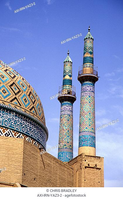 Low angle view of colorful minarets and dome, Jami Mosque, Yazd, Iran