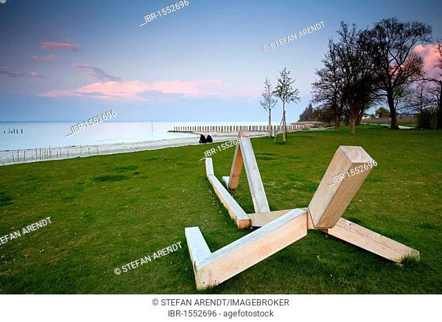 Wooden sculpture at the harbour of Altnau at Lake Constance in evening light, Altnau municipality, Switzerland, Europe