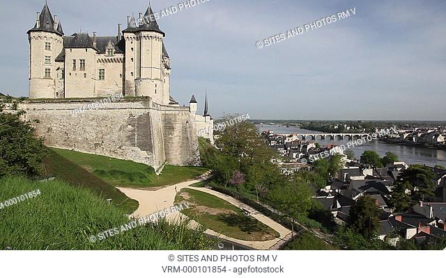 Exterior, Locked Down Shot, Daylight, view of the castle's southeastern side. Seen are the walls, spires and pinnacles of this elegant castle