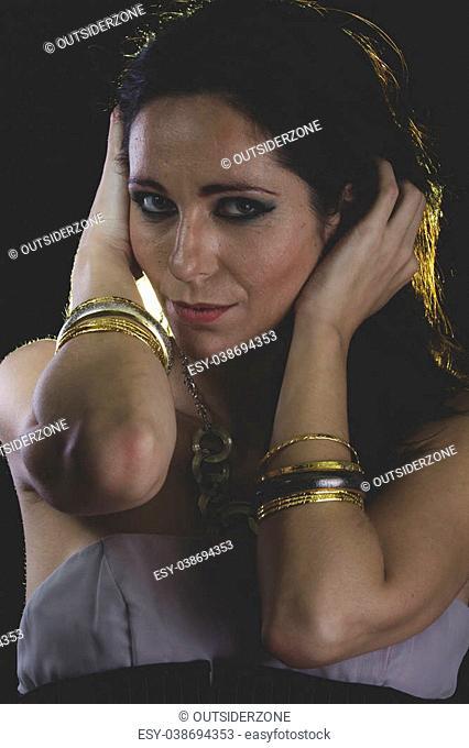woman with Venetian mask metal, sad and pensive