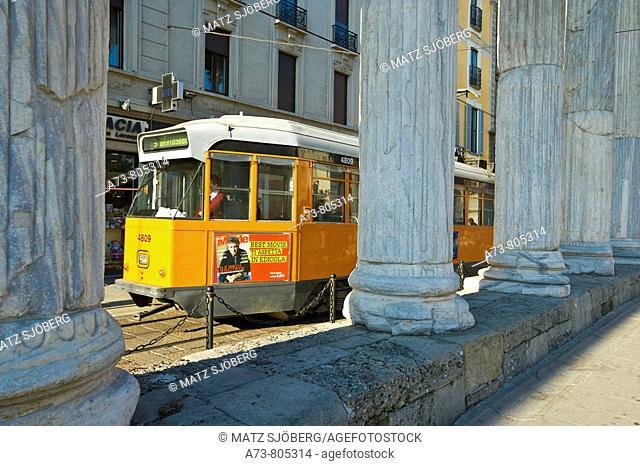 Tram near the Colonne di San Lorenzo Roman ruins, Milan. Lombardy, Italy