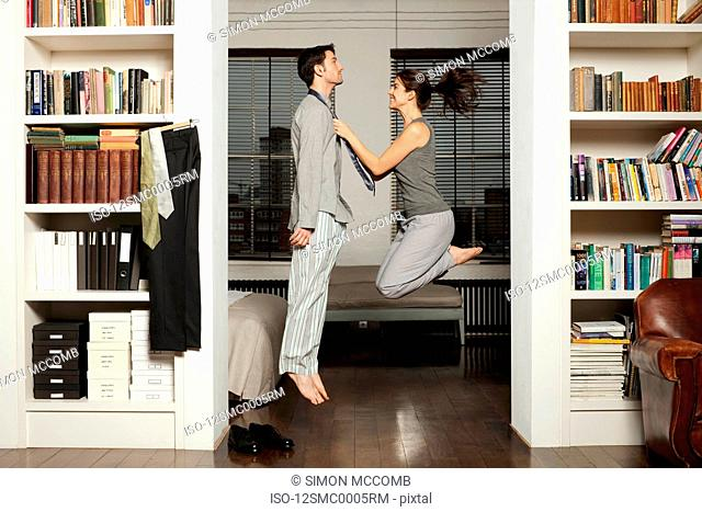 couple jumping and getting dressed