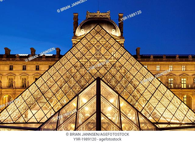 Glass pyramid and ancient architecture of Musee du Louvre, Paris France