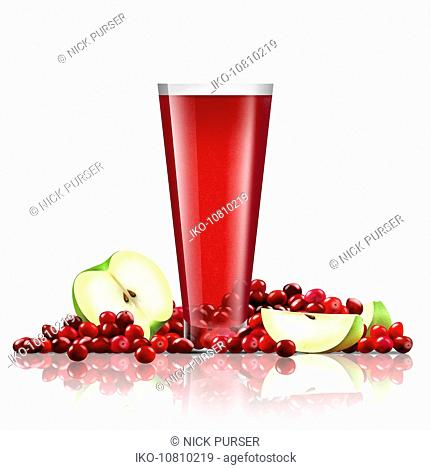 Fresh cranberries and slices of apple with glass of juice