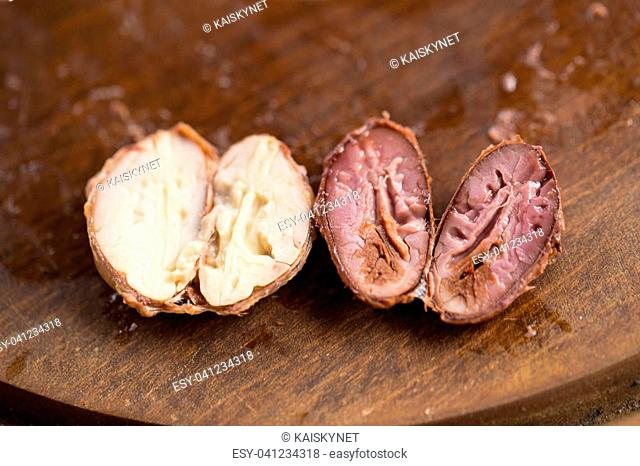 Choosing raw cacao beans with hand of man