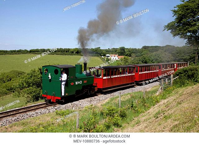 Steam train with red carriages. Lynton & Barnstaple narrow gauge railway Woody Bay Station - Parracombe - Lynton - North Devon - UK