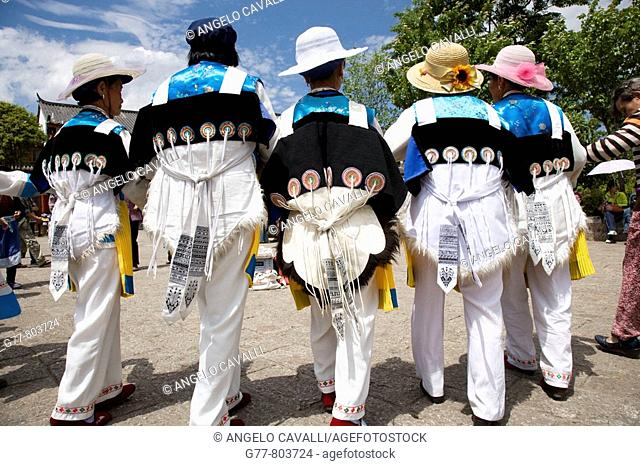 China  Yunnan Province  Lijiang  The Old Town  Naxi minority women dancing in Sifang Square