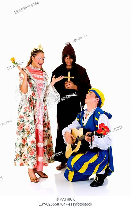 Halloween fairytale, Cinderella wearing gown, prince with guitar, priest in back. Studio, white background