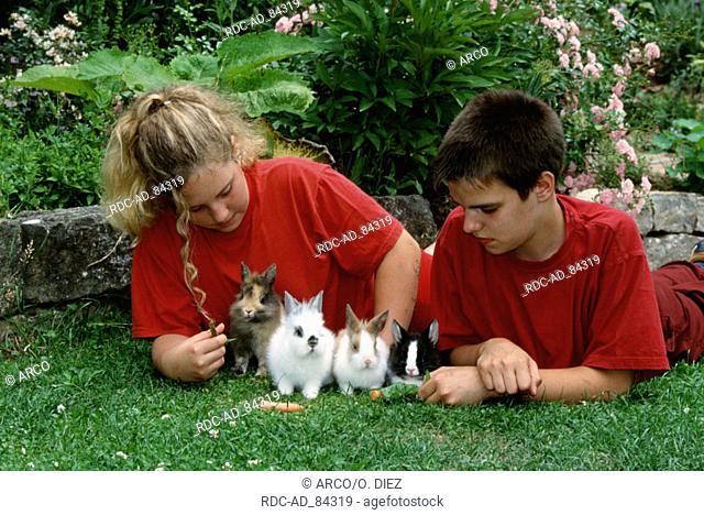 Children with Dwarf Rabbits young