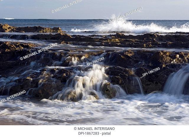 lava shelves and surf, salt pond beach park, kauai, hawaii, usa