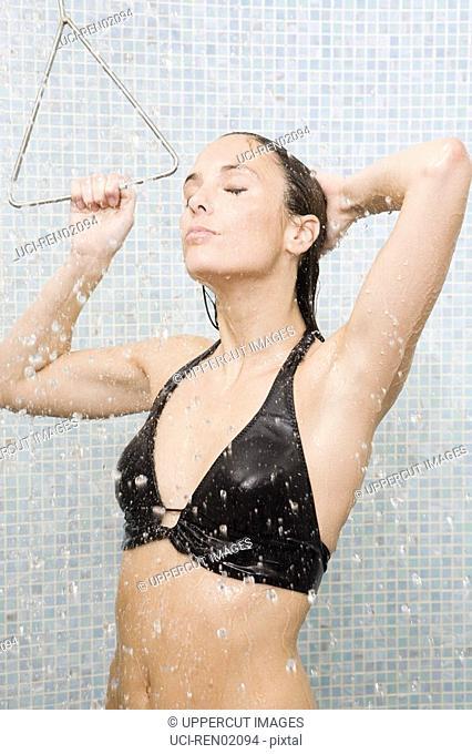Woman in bathing suit taking shower