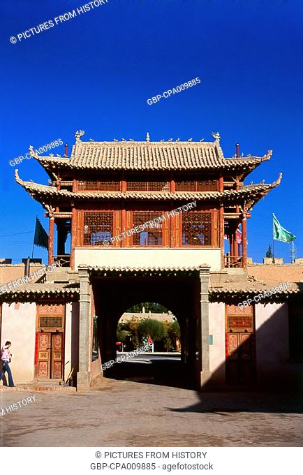 China: An old caravanserai, now a museum, next to the sand dunes of Mingsha Shan (Mingsha Hills) in the Kumtagh Desert, Dunhuang, Gansu Province