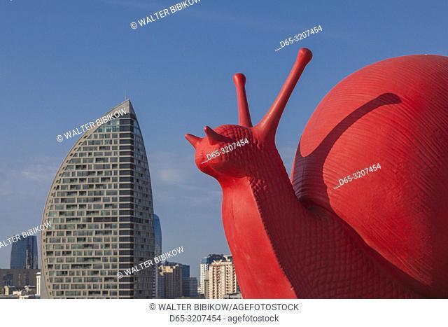 Azerbaijan, Baku, Trump Hotel and Tower and big red snail by the Heydar Aliyev Center, NR