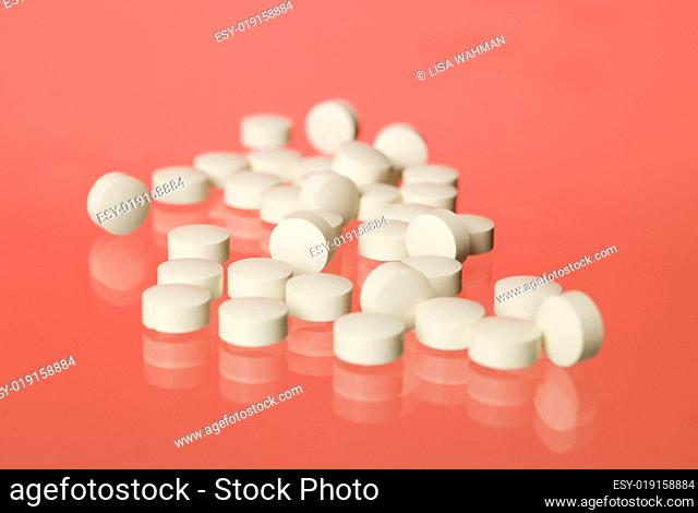 Pills towards red background