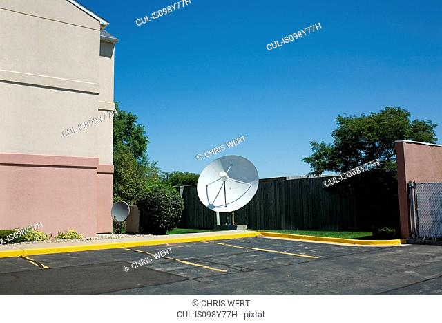 Satellite dish in parking lot