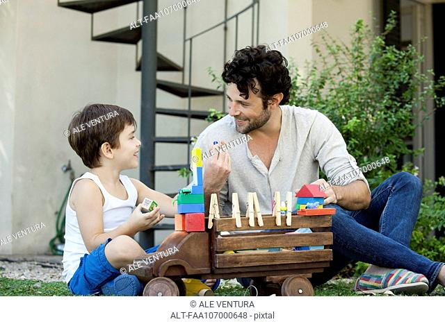 Father and son playing with toys together