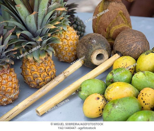 Fruit and two coconut pipes on table - Antigua