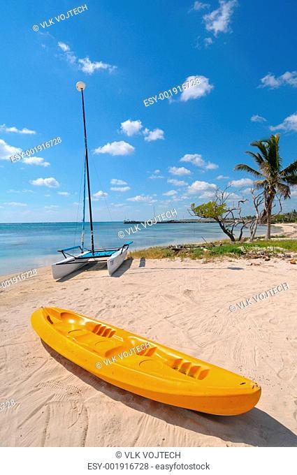 Picture of yellow boat on the mahahual beach
