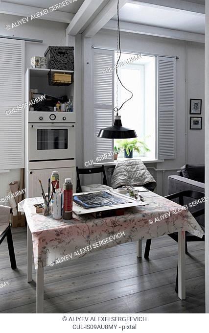 Room interior, artist materials on table