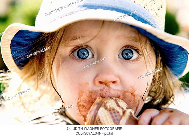 Young girl eating ice cream cone