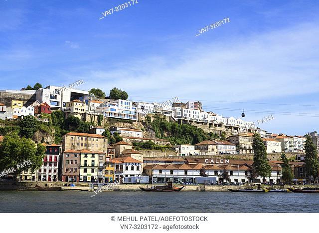 View of Vila Nova de Gaia from north bank of river Douro in Porto, Portugal. Vila Nova de Gaia is famed for housing Porto's Port wine cellars