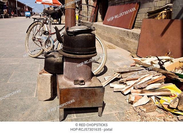 Traditional stove and a kettle at the roadside, HohHot, Inner Mongolia, China