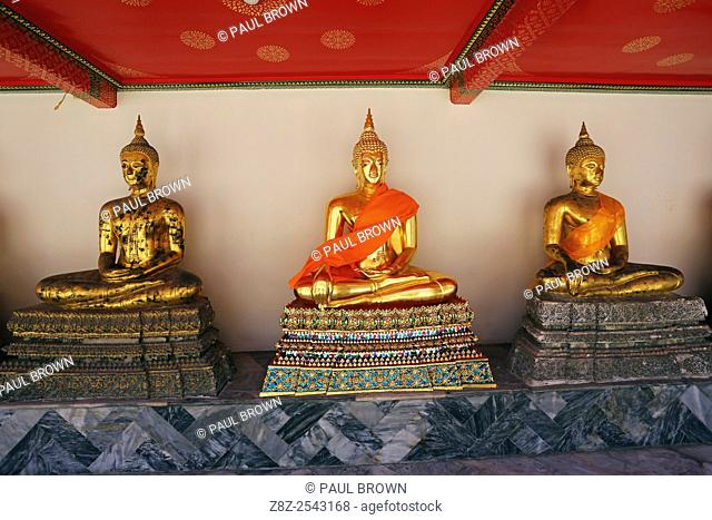 Golden Buddha statues at Wat Pho temple, Bangkok, Thailand
