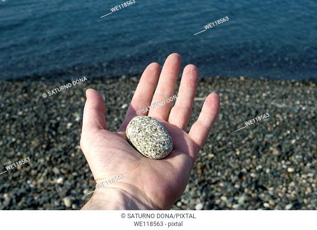 Stone on the palm of the hand
