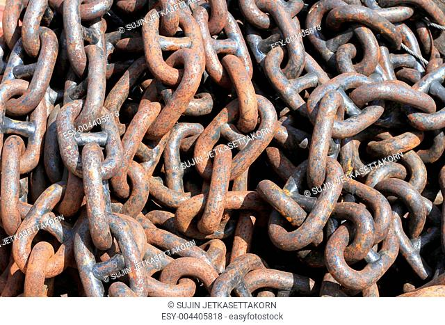 A close up of a rusty chain