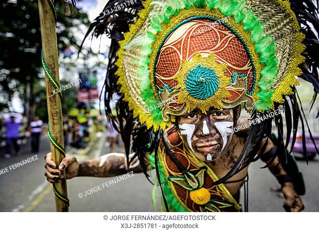 """Participants of the parade during the celebration of Dinagyang in homage to """"""""The Santo Niño"""""""", the patron saint of many Philippino cities"""