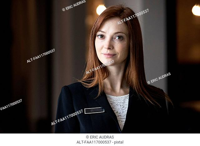 Female receptionist standing in hotel