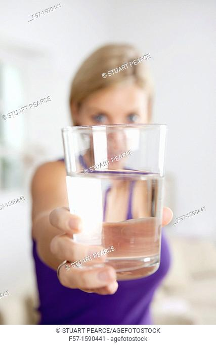 Attractive young woman with glass of water