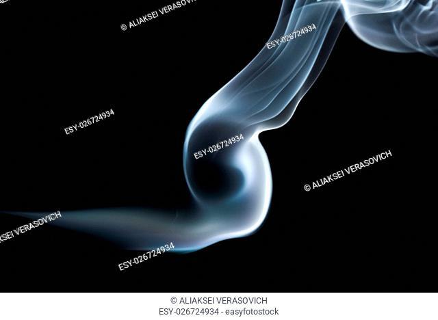 Abstract smoke wave on black background. Studio shot