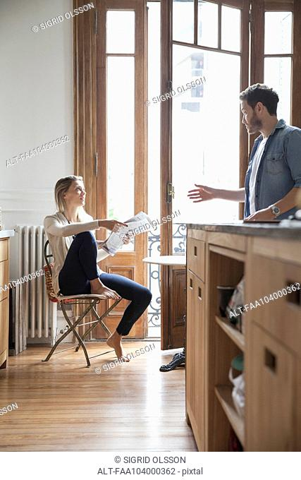 Couple chatting in kitchen