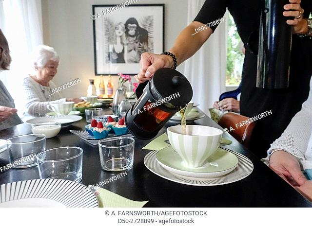 Fika, coffee, club for retirees to help them socialize and get out, Stockholm, Sweden