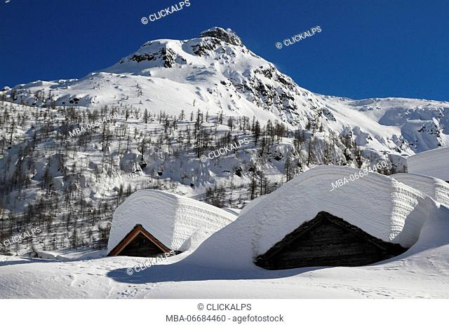 Alpe Lendine huts, in Valle Spluga, almost completely covered by snow, Olmo, Province of Sondrio, Lombardy; Italy
