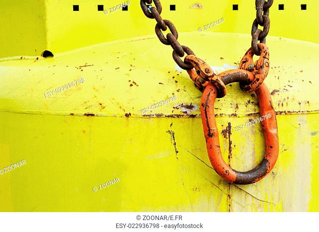 Red carabiner on yellow bottle