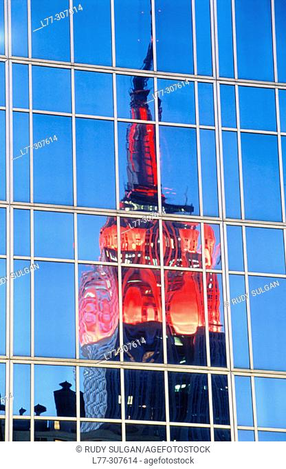 Empire State Building reflecting in Midtown Manhattan. New York City, USA