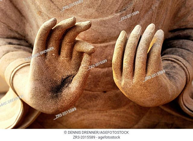 Details of a Buddha statue's hands in a temple in a village near Battambang, Cambodia