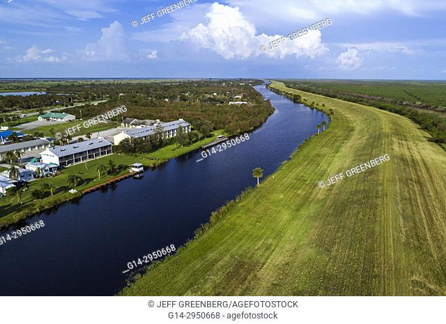 Florida, Lakeport, water, canal, Lake Okeechobee levee Herbert Hoover dike, canal, Lakeport Motel And Restaurant, aerial overhead bird's eye view above