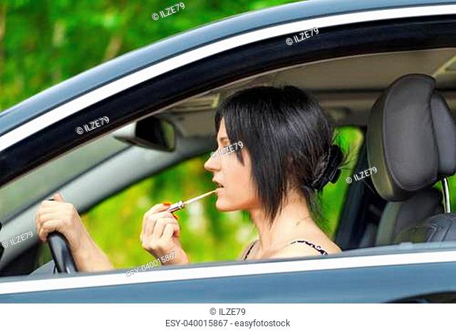 Woman with the lipstick in the car