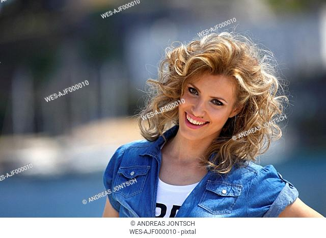 Greece, Portrait of Young woman smiling, close up