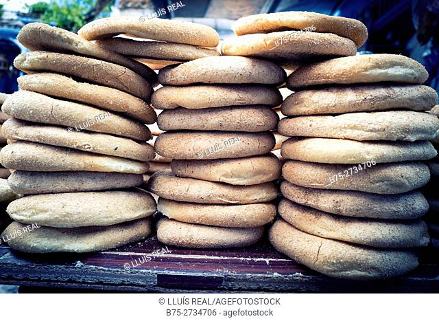 Basic Moroccan breads stacked on a table. Chaouen, Morocco