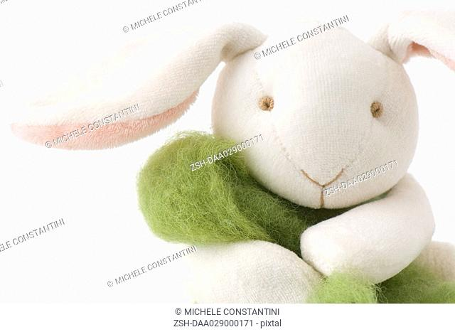 Stuffed rabbit holding wool, portrait