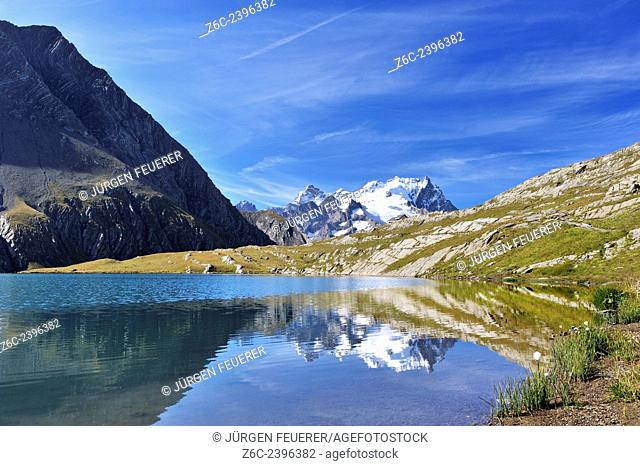 Lac du Goléon with the mirroring of mountain La Meije and its glaciers, Écrins, Hautes-Alpes, French Alps, France